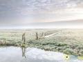 Mist boven het Oudeland van Strijen gemaakt door Jeffrey Groeneweg