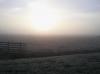 Foto van de week 50 - Wilma de Jong - Mist en de opkomende zon vanaf de Keizersdijk