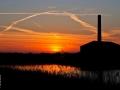 Een mooie foto van de zonsondergang bij Verzorgingstehuis de Hoge Weide door Marc van der Stelt.